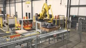 Автоматизирано <strong>етикетиране</strong> и палетизиране с роботи FANUC в StrongPoint Automation