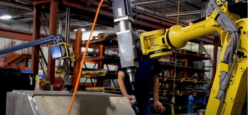 Автоматизирана станция за пробиване на метални колони с робот FANUC